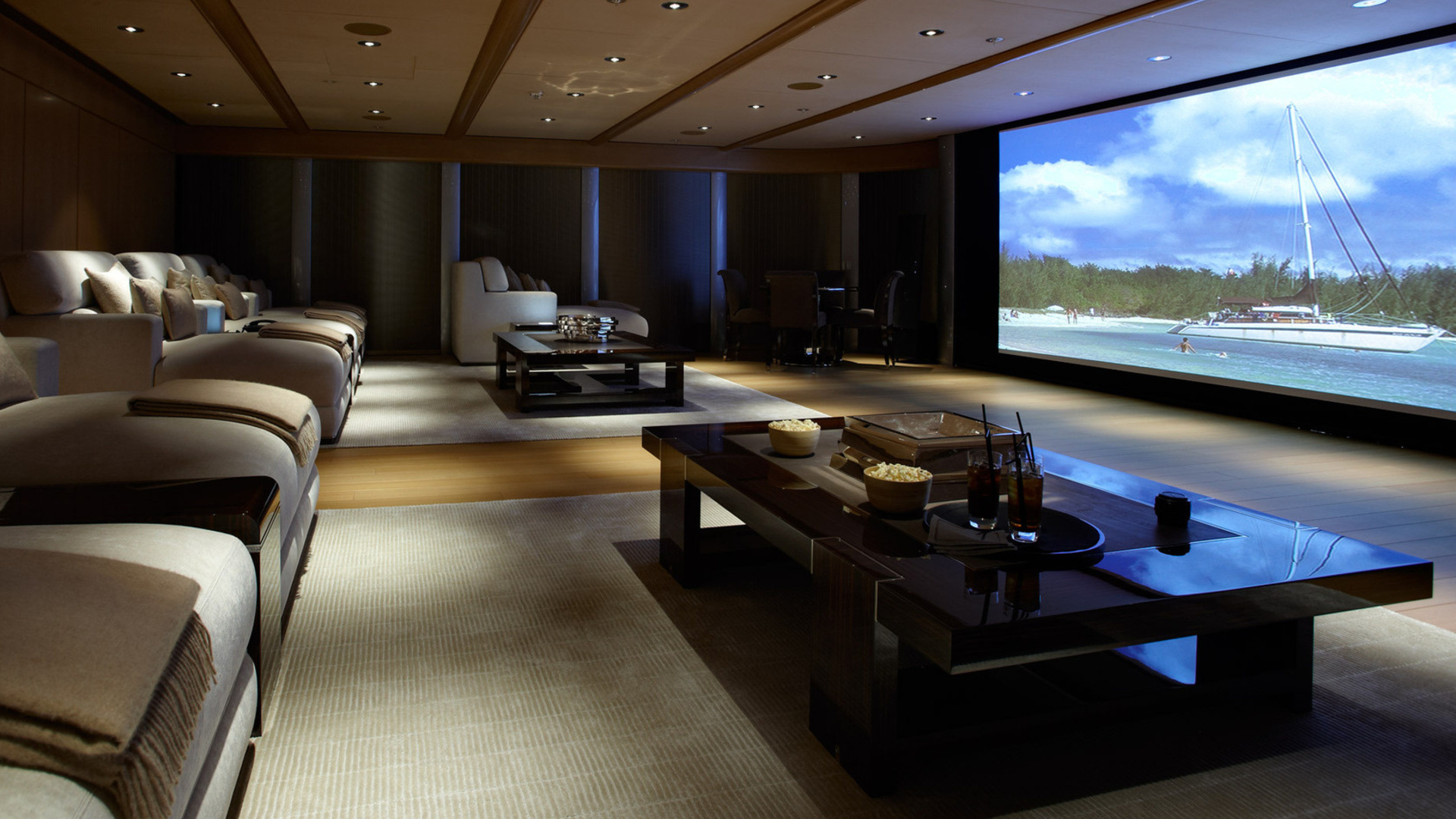 Wide-space-for-designing-home-theater-with-small-lamps-and-tile-ceiling-model-and-wooden-floor-and-amusing-table-and-comfort-couchs